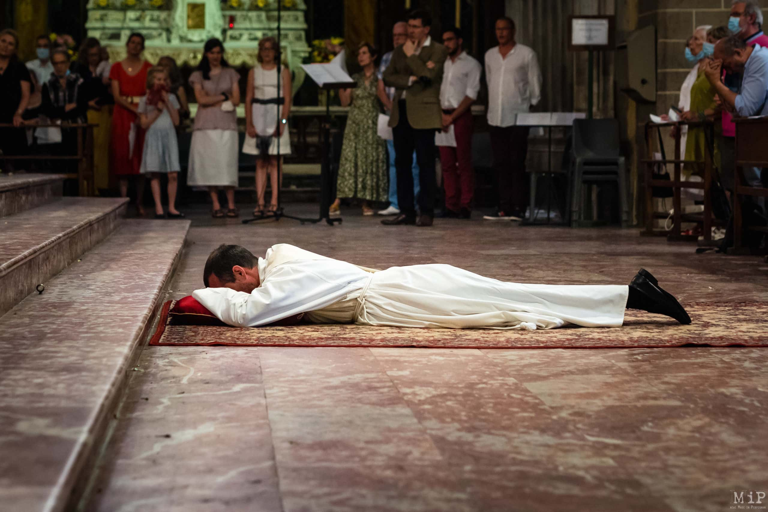 France, Perpignan, 2021-06-27. After 7 years spent in the seminary, Abbe Damien de Ricard was consecrated by no less than three bishops. Monsignor Norbert Turini, bishop of the diocese of Perpignan-Elne, was accompanied in this ceremony by Monsignor David Macaire, archbishop of Saint-Pierre and Fort-de-France in Martinique and Monsignor Raymond Centene, bishop of Vannes since 2005. In the diocese of Perpignan-Elne, there had not been an ordination for 8 years. June is traditionally the month of ordinations in the Catholic Church. The month when former seminarians become priests in a highly codified ceremony. In 2021, 130 ordinands will become priests on Sunday 27 June, the closest to 29 June, the feast of St Peter and St Paul, two of the pillars of the Catholic tradition. Photograph by Arnaud Le Vu / Hans Lucas.France, Perpignan, 2021-06-27. Apres 7 ans passes au seminaire, l abbe Damien de Ricard, a ete consacre par pas moins de 3 eveques. Monseigneur Norbert Turini, eveque du diocese de Perpignan-Elne, etait accompagne dans cette ceremonie par Monseigneur DavidMacaire, archeveque de Saint-Pierre et Fort-de-France en Martinique et Monseigneur RaymondCentene eveque de Vannes depuis 2005. Dans le diocese de Perpignan-Elne, il n y avait pas eu d ordination depuis 8 ans. Le mois de juin est traditionnellement celui des ordinations dans l Eglise catholique. Le mois ou les anciens seminaristes deviennent pretre lors d une ceremonie fort codifie. En 2021, ils sont 130 ordinants a devenir pretre en ce dimanche 27 juin, le plus proche du 29 juin, fete de Saint-Pierre et Saint-Paul, deux des apotres piliers de la tradition catholique. Photographie de Arnaud Le Vu / Hans Lucas.
